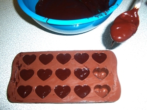 Pouring chocolate ito moulds